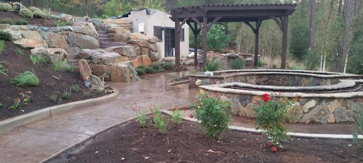 a picture of backyard of concrete and stone walls in rocklin, ca