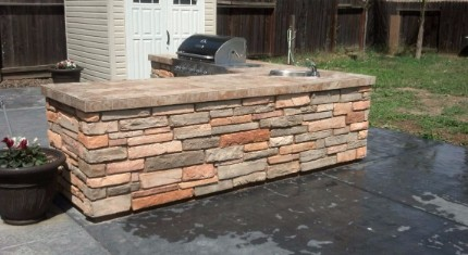 picture of a stacked stone and concrete countertop witha barbecue installed into it in Rocklin, California