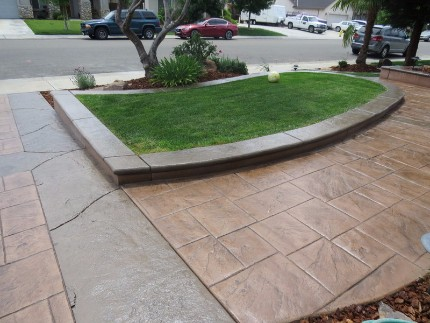 a stamped concrete driveway and mowing strip outside of a home in Rocklin, California